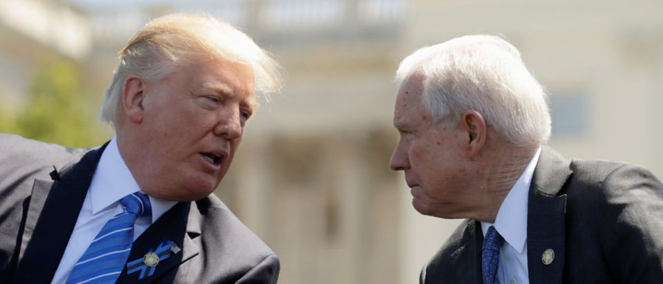President Donald Trump speaks with Attorney General Jeff Sessions as they attend the National Peace Officers Memorial Service on the West Lawn of the U.S. Capitol in Washington, U.S., May 15, 2017. REUTERS/Kevin Lamarque
