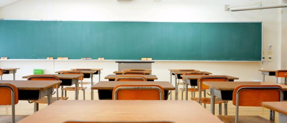Pictured is an empty classroom. (Shutterstock/maroke