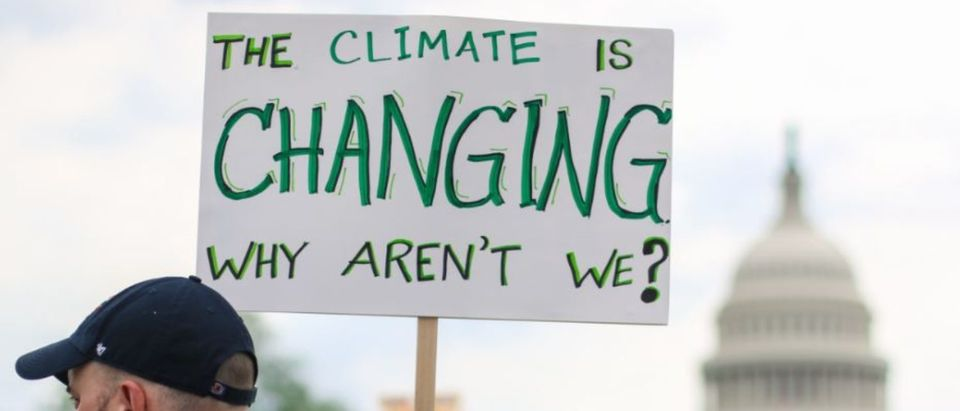 Washington, DC - April 29, 2017: Thousands of people attend the People's Climate March to stand up against climate change. (Shutterstock/Nicole S Glass) | MeToo Movement Takes Toll On California | Climate Lawsuits Find A Convenient Ally