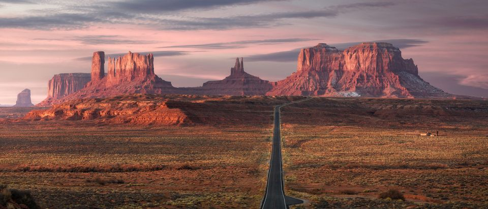 Forrest Gump Point, red rock at Monument Valley, Navajo Tribal Park, Arizona USA. Stunning view and scenic road in Utah during sunrise. Depth of long empty road. (Shutterstock)