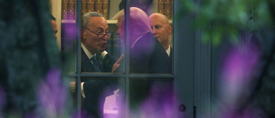 Senate Minority Leader Chuck Schumer makes a point to President Donald Trump in the Oval Office prior to his departure from the White House September 6, 2017 in Washington, D.C. (Photo by Alex Wong/Getty Images)