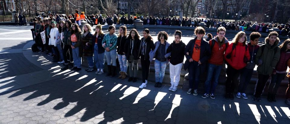 Students from Harvest Collegiate High School form a circle around the fountain in Washington Square Park on March 14, 2018 in New York to take part in a national walkout to protest gun violence, one month after the shooting in Parkland, Florida, in which 17 people were killed. (Photo: TIMOTHY A. CLARY/AFP/Getty Images)
