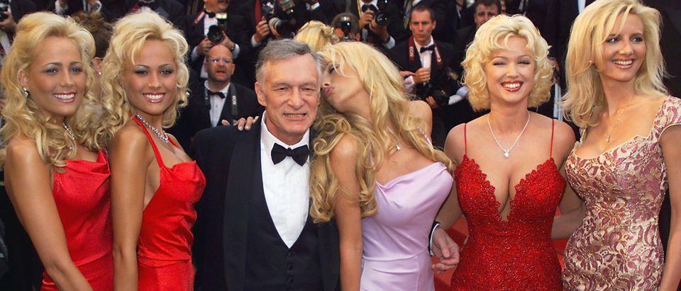 Playboy magazine president Hugh Hefner (C) poses w