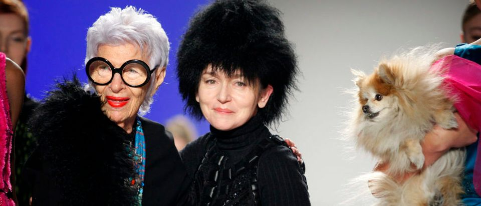 Designer Joanna Mastroianni stands next to designer Iris Apfel on the runway during Fall/Winter 2012 collection during New York Fashion Week