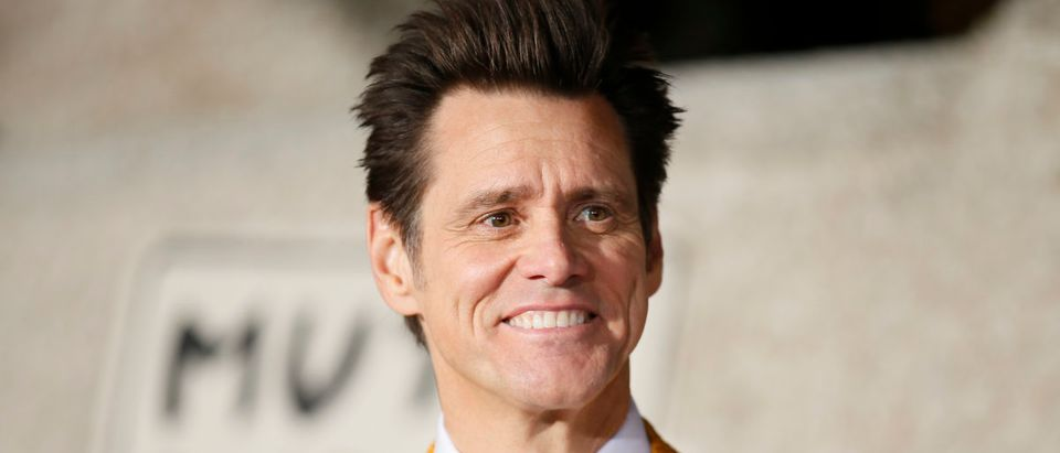 """Actor Jim Carrey poses at the world premiere of the film """"Dumb and Dumber To"""" in Los Angeles, November 3, 2014. REUTERS/Danny Moloshok"""