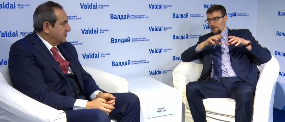 Joseph Mifsud (L) and Ivan Timofeev (R) are pictured at a Valdai Discussion Club event, May 2016. (Photo: Screenshot/Valdai Club/YouTube)