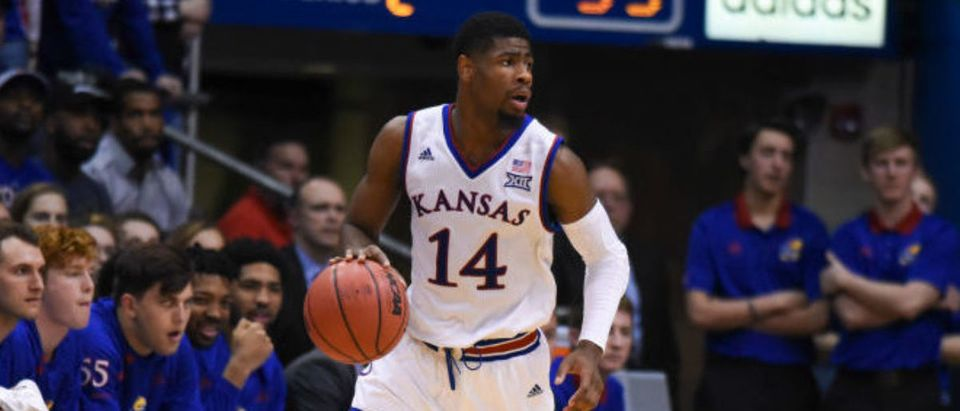 LAWRENCE, KS - FEBRUARY 19: Malik Newman #14 of the Kansas Jayhawks controls the ball against the Oklahoma Sooners at Allen Fieldhouse on February 19, 2018 in Lawrence, Kansas. (Photo by Ed Zurga/Getty Images)