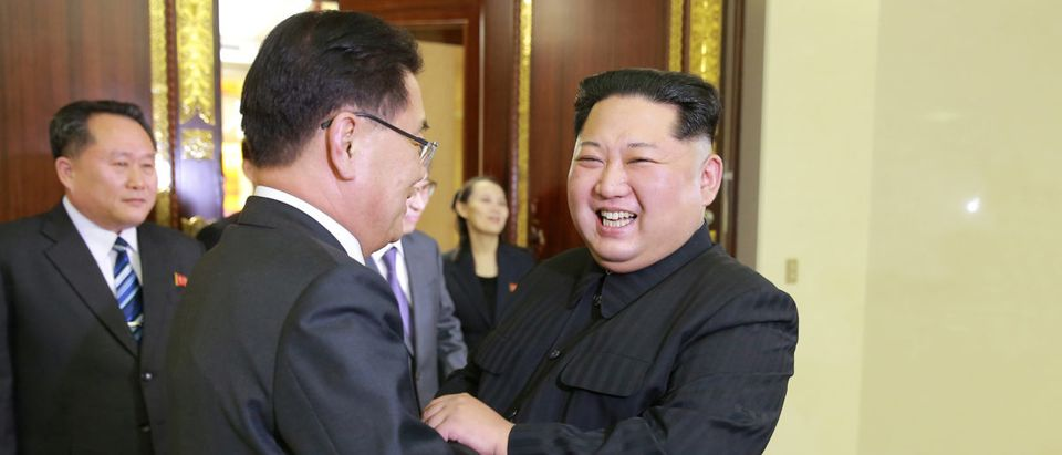 North Korean leader Kim Jong Un greets a member of the special delegation of South Korea's President at a dinner in this photo released by North Korea's Korean Central News Agency