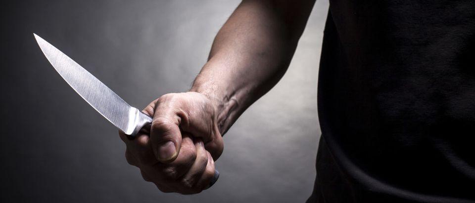 Man With A Knife (Shutterstock/ BortN66)