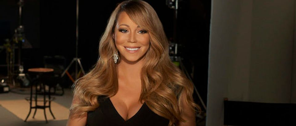 "In this handout image provided by CF Publicity, Singer Mariah Carey smiles in an unspecified location on February 13, 2013. Carey has recorded the song, ""Almost Home"" for the soundtrack to the Disney feature film ""Oz The Great and Powerful"" directed by Sam Raimi in theatres in the US on March 8. (Photo by CF Publicity via Getty Images)"