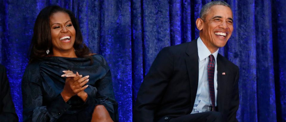Former U.S. President Barack Obama sits with former first lady Michelle Obama prior during the unveiling of their portraits at the Smithsonians National Portrait Gallery in Washington, U.S., February 12, 2018. REUTERS/Jim Bourg
