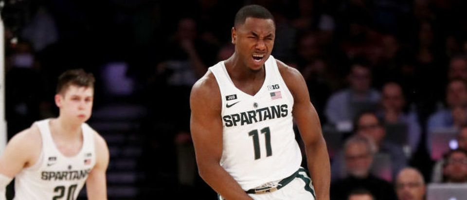 NEW YORK, NY - MARCH 02: Lourawls Nairn Jr. #11 of the Michigan State Spartans celebrates the win at the buzzer as Ethan Happ #22 of the Wisconsin Badgers reacts during quarterfinals of the Big Ten Basketball Tournament at Madison Square Garden on March 2, 2018 in New York City. (Photo by Elsa/Getty Images)