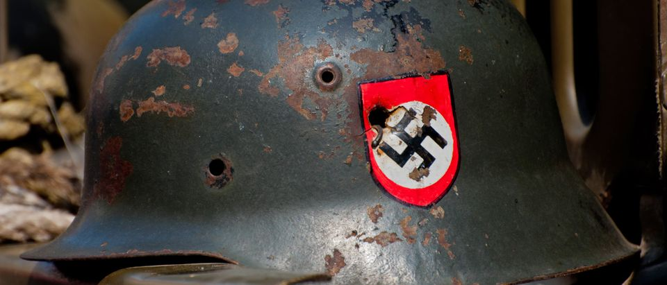 PRAGUE, CZECH REP. - 29 APRIL: Nazi helmet on American historical Jeep of Old Car Rangers club on April 29, 2011. It is part of reenactment event - the fall of German army in Prague in 1945. Shutterstock