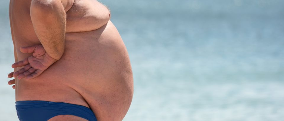 Obese man in bathing suit