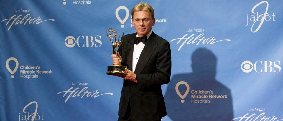 Pat Sajak poses backstage at the 38th An