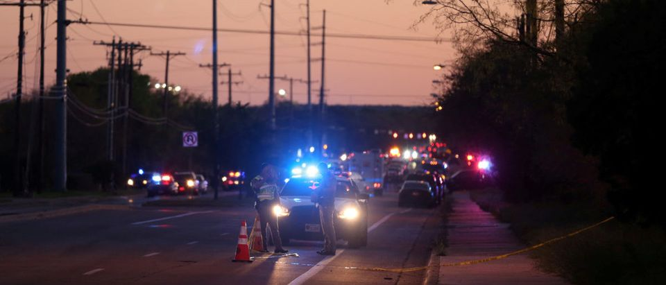 Law enforcement personnel investigate an incident that they said involved an incendiary device in the 9800 block of Brodie Lane in Austin, Texas, U.S., March 20, 2018. REUTERS/Loren Elliott