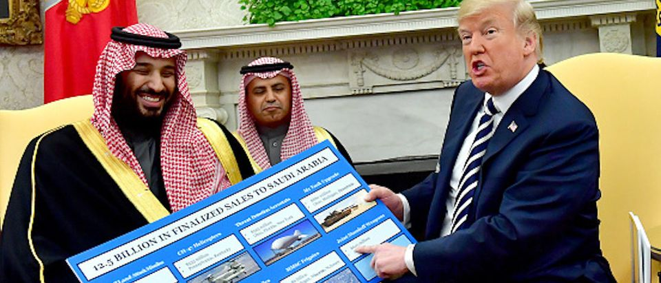 WASHINGTON, DC - MARCH 20: President Donald Trump (R) holds up a chart of military hardware sales as he meets with Crown Prince Mohammed bin Salman of the Kingdom of Saudi Arabia in the Oval Office at the White House on March 20, 2018 in Washington, D.C. (Photo by Kevin Dietsch-Pool/Getty Images) | State Dept 13 Mill Arms Sale Saudi Arabia