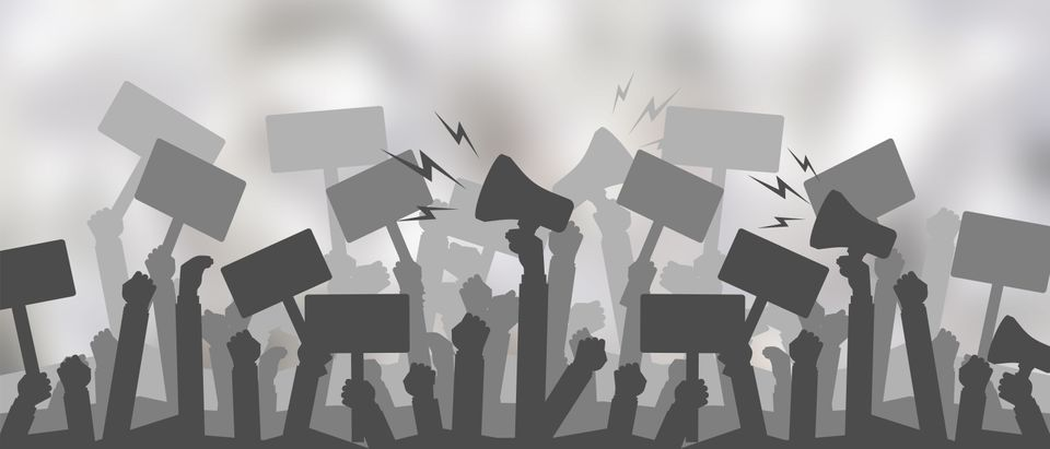Silhouette crowd of people protesters. Protest, revolution, conflict. Shutterstock.