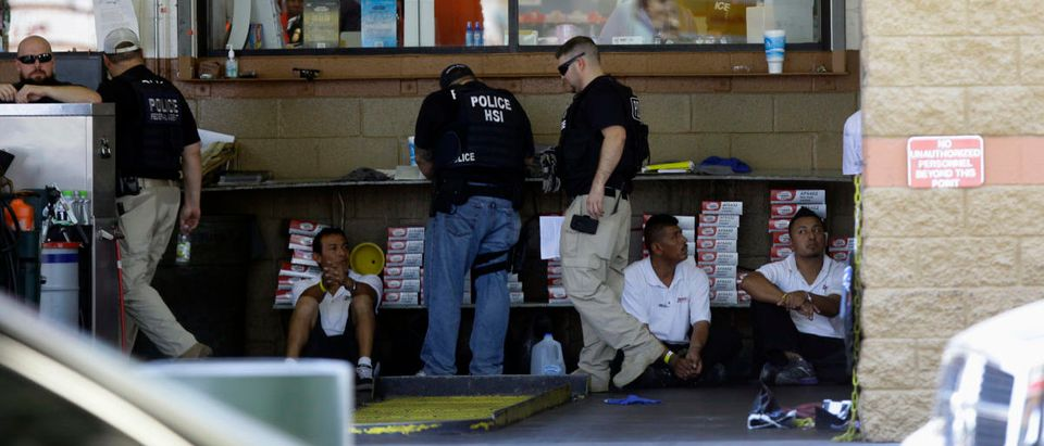 The ICE Homeland Security Investigations agents detain workers at Danny's Family Car Wash in Phoenix, Arizona