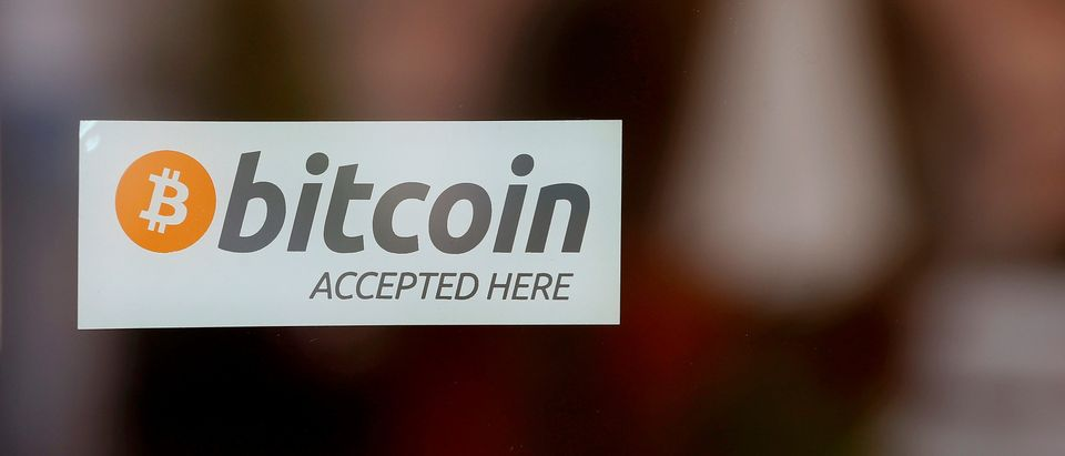 "A sticker reading ""Bitcoin accepted here"" is displayed at the entrance of the Stadthaus town hall in Zug"