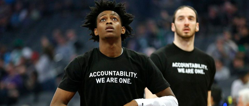 Sacramento Kings guard De'Aaron Fox stands on the court before the start of the game against the Boston Celtics at Golden 1 Center, March 25, 2018, in Sacramento, California. Players from both teams wore T-shirts during warmups in honor of Stephon Clark, a Sacramento native who was recently shot and killed by Sacramento police. Photo: Cary Edmondson-USA TODAY Sports