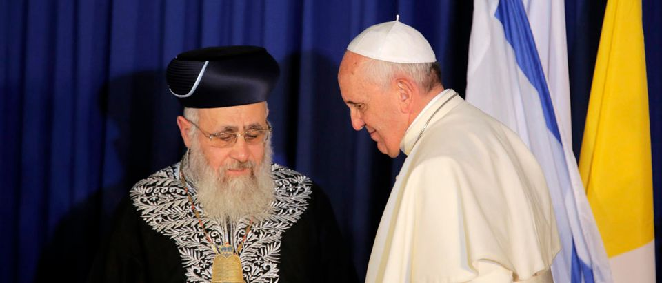 Pope Francis (R) stands next to Israel's Chief Sephardic Rabbi Yitzhak Yosef during a ceremony in Jerusalem May 26, 2014. Francis navigated the minefield of the Israeli-Palestinian conflict and humbly bowed to kiss the hands of Holocaust survivors on Monday, the last day of a Mideast trip laden with bold personal gestures. REUTERS/Ammar Awad