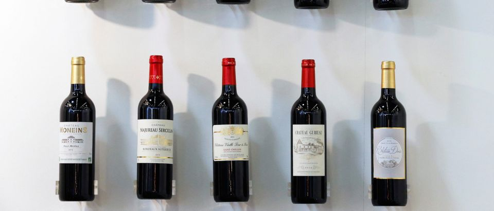 Bottles of red wine are displayed at the wine fair Vinexpo in Bordeaux