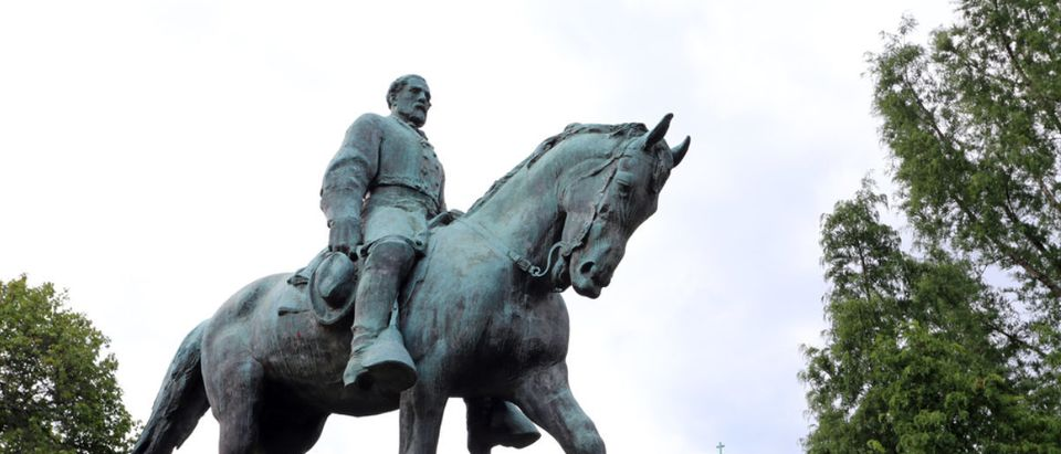CHARLOTTESVILLE, VA - JULY 14: A statue of Robert E. Lee in Emancipation Park in Charlottesville, VA on July 14, 2017. The site has been the target of repeated white nationalist protests. (Shutterstock/Katherine Welles)