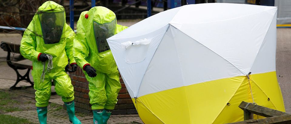 The forensic tent, covering the bench where Sergei Skripal and his daughter Yulia were found, is repositioned by officials in protective suits in the centre of Salisbury