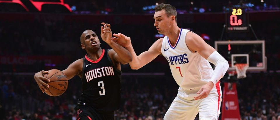LOS ANGELES, CA - JANUARY 15: Chris Paul #3 of the Houston Rockets drives on Sam Dekker #7 of the LA Clippers during the first half at Staples Center on January 15, 2018 in Los Angeles, California. (Photo by Harry How/Getty Images)