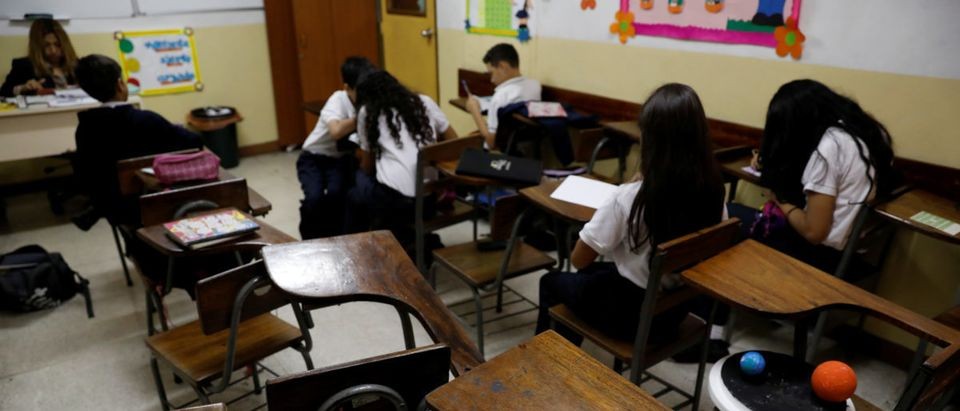 Empty desks are seen in the classroom of a school on a day of protests in Caracas