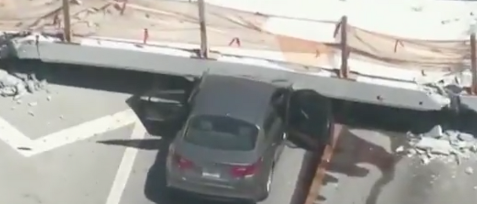 A recently installed pedestrian bridge located on Florida International University's campus collapsed Thursday afternoon leaving at least one dead and multiple injured. (Photo: Screen Shot/Youtube/FIU Bridge Collapses)