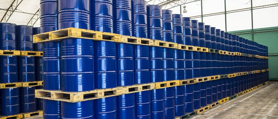 Oil drums stacked in storage.