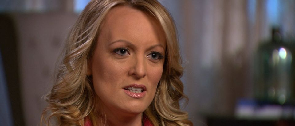 Stormy Daniels, an adult film star and director whose real name is Stephanie Clifford is interviewed by Anderson Cooper of CBS News' 60 Minutes program in early March 2018, in a still image from video provided March 25, 2018. CBSNews/60 MINUTES/Handout via REUTERS. ATTENTION EDITOR - THIS IMAGE WAS TAKEN BY A THIRD PARTY. NO ARCHIVES, NO RESALES, MANDATORY CREDIT. | Stormy Sues Cohen For Defamation