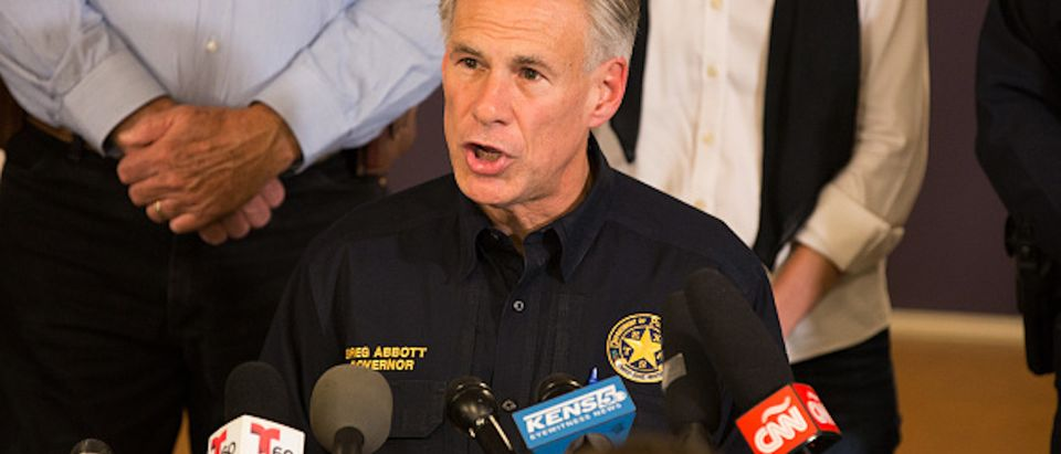 "Texas Governor Greg Abbott speaks at a press conference on November 5, 2017, in Sutherland Springs, Texas about the First Baptist Church mass shooting. ""There are 26 lives that have been lost. We don't know if that number will rise or not, all we know is that's too many, and this will be a long, suffering mourning for those in pain,"" Abbott said. / AFP PHOTO / SUZANNE CORDEIRO (Photo credit should read SUZANNE CORDEIRO/AFP/Getty Images)"