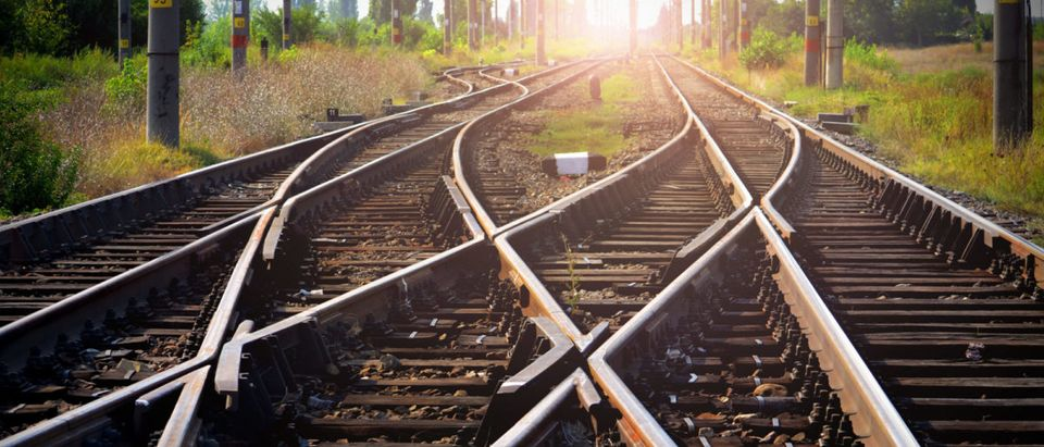 Train tracks are leading into the sunset. (Shutterstock)