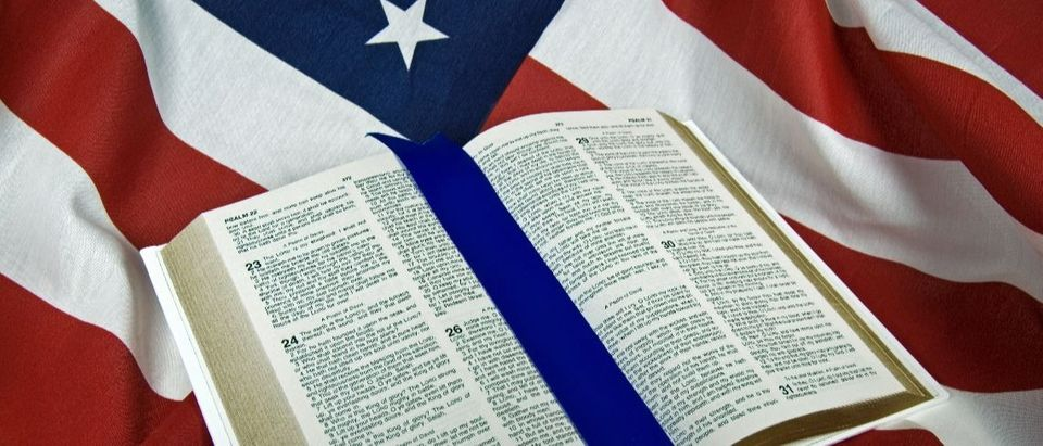 USA flag and Bible Shutterstock/Maria Dryfhout