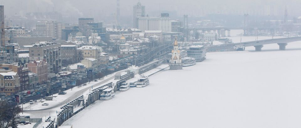 A view of the frozen River Dnieper in an air temperature around minus 18 degree Celsius (minus 4 Fahrenheit) in snow covered central Kiev, February 3, 2012. Thirty-eight more deaths from a cold snap have been registered in Ukraine in the past 24 hours, bringing to 101 the toll from freezing temperatures across the former Soviet republic, the Emergencies Ministry said on Friday. REUTERS/Gleb Garanich