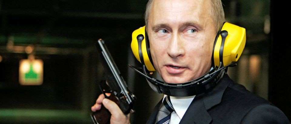 FILE PHOTO: Russian President Vladimir Putin stands with a gun at a shooting gallery of the new GRU military intelligence headquarters building as he visits it in Moscow November 8, 2006. REUTERS/ITAR-TASS/PRESIDENTIAL PRESS SERVICE