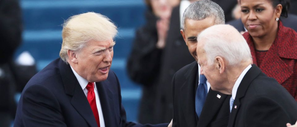 Vice President Joe Biden (R) shakes hands with President elect Donald Trump at inauguration ceremonies swearing in Donald Trump as the 45th president of the United States on the West front of the U.S. Capitol in Washington, U.S., January 20, 2017. REUTERS/Carlos Barria