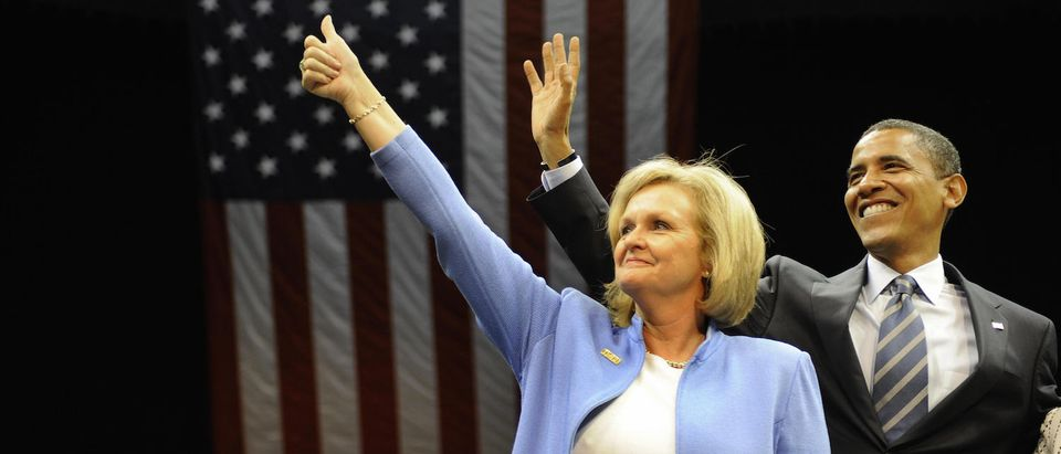 """US Democratic presidential candidate Illinois Senator Barack Obama waves with Senator Claire McCaskill (D-MO) during a """"Women's Rally For The Change We Need"""" at Bank United Center in Coral Gables, Florida, September 19, 2008. AFP (Photo: EMMANUEL DUNAND/AFP/Getty Images) 