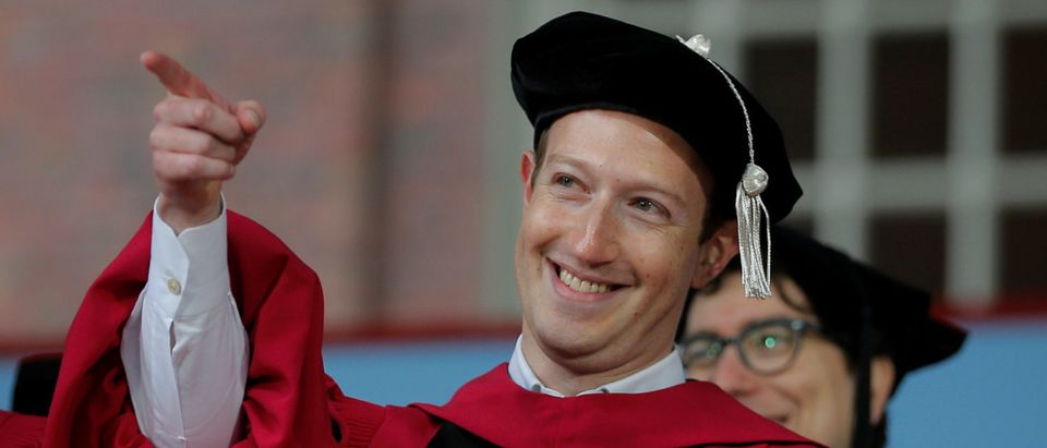 Facebook founder Mark Zuckerberg acknowledges a cheer from the crowd before receiving an honorary Doctor of Laws degree, as fellow honorary degree recipient actor James Earl Jones (L) looks on, during the 366th Commencement Exercises at Harvard University in Cambridge, Massachusetts, U.S., May 25, 2017. REUTERS/Brian Snyder TPX IMAGES OF THE DAY - RC1167855BD0