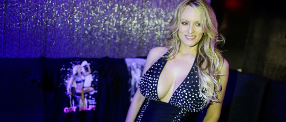 Adult-film actress Stephanie Clifford, also known as Stormy Daniels, poses for pictures at the end of her striptease show in Gossip Gentleman club in Long Island, New York, U.S., February 23, 2018. REUTERS/Eduardo Munoz | Stormy Daniels Talks Alleged Threat | Stormy Daniels Extends Strip Club Tour