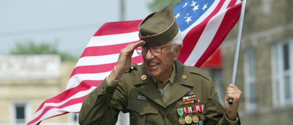 veteran with flag Shutterstock/Anthony Correia