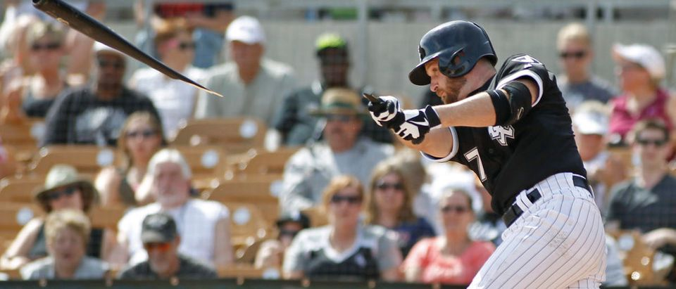 Chicago White Sox's Jeff Keppinger breaks his bat against the Milwaukee Brewers during their MLB Cactus League spring training baseball game in Glendale, Arizona, March 21, 2013. REUTERS/Ralph D. Freso
