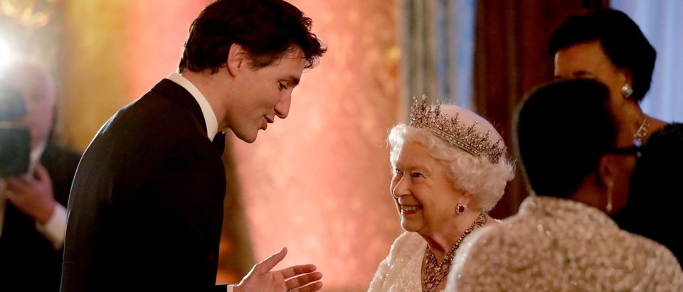 Britain's Queen Elizabeth II greets Canadian Prime Minister Justin Trudeau in a receiving line for the Queen's Dinner for the Commonwealth Heads of Government Meeting (CHOGM) at Buckingham Palace in London