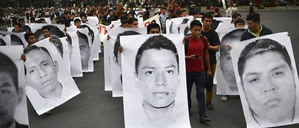 Relatives and comrades of the 43 students of the teaching training school in Ayotzinapa who went missing on September 2014 hold a demonstration to mark 43 months since their disappearance, in Mexico City on April 26, 2018. (Photo: YURI CORTEZ/AFP/Getty Images)