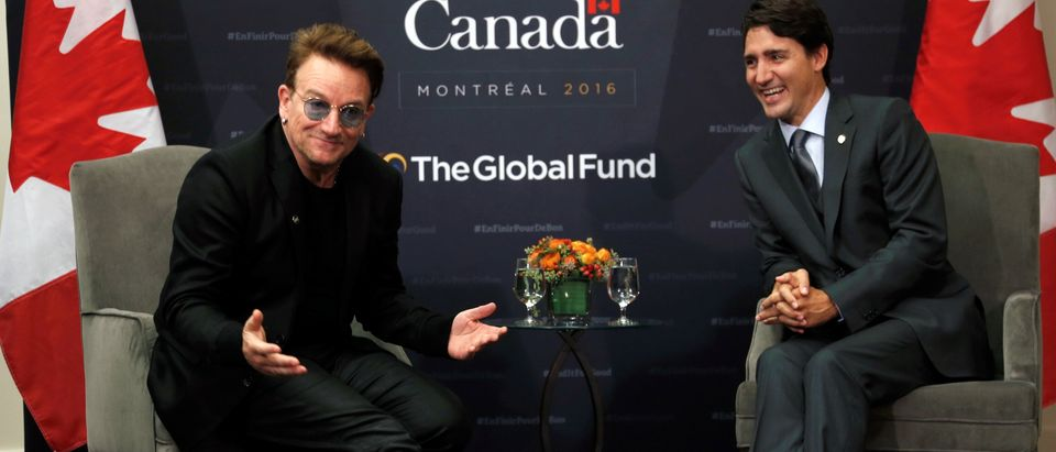 Canada's Prime Minister Justin Trudeau laughs as singer Bono makes a comment during a meeting at the Fifth Replenishment Conference of the Global Fund to Fight AIDS, Tuberculosis and Malaria in Montreal