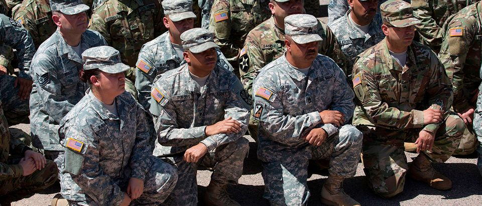 """Members of the Arizona National Guard listen to Arizona Gov. Doug Ducey on April 9, 2018 at the Papago Park Military Reservation in Phoenix, Arizona. Arizona deployed its first 225 National Guard members to the Mexican border on Monday after President Donald Trump ordered thousands of troops to the frontier region to combat drug trafficking and illegal immigration. """"The Arizona National Guard will deploy 225 members of the Guard today to support border security measures,"""" the state militia said in a statement. CAITLIN O'HARA/AFP/Getty Images 