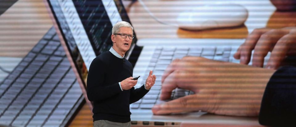 CHICAGO, IL - MARCH 27: Apple CEO Tim Cook introduces Apple's new iPad during an event at Lane Tech College Prep High School on March 27, 2018 in Chicago, Illinois. The device will work with Apple Pencil and is available today. (Photo by Scott Olson/Getty Images) | Apple To Replace Intel Chips With Its Own